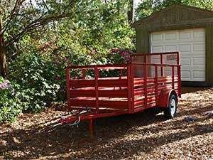 red utility trailer that can be used for small hauling jobs