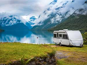 travel trailer family vacation on a lake with scenic view