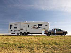 truck and fifth wheel camper trailer on highway