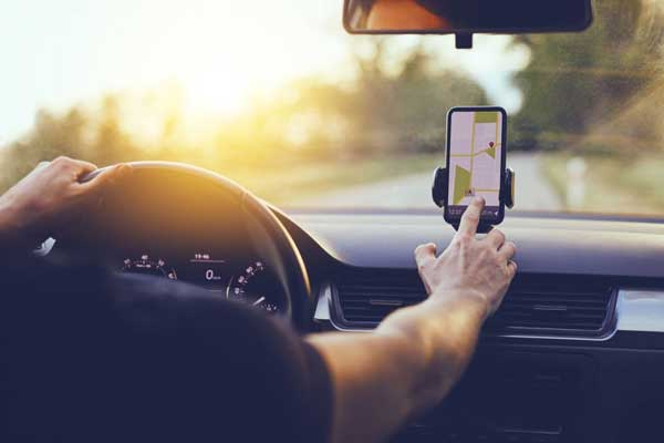 man using iphone maps during a roadside emergency in arkansas