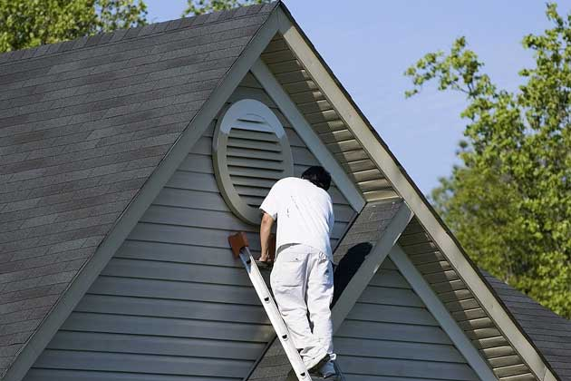painting insurance work high in air